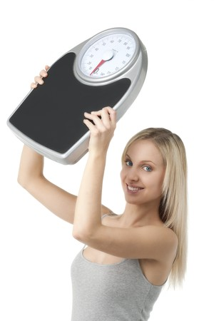 Satisfied woman raising her scale Stock Photo - 7368773