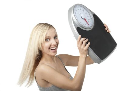 Satisfied woman raising her scale Stock Photo - 7368764