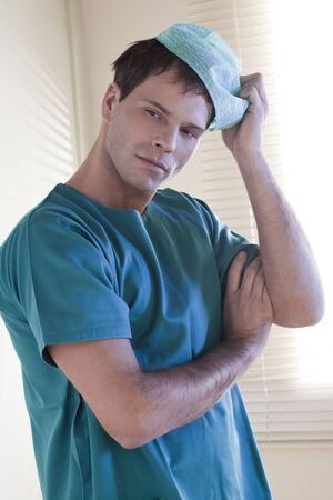 Portrait of a tired male surgeon Stock Photo - 7368861
