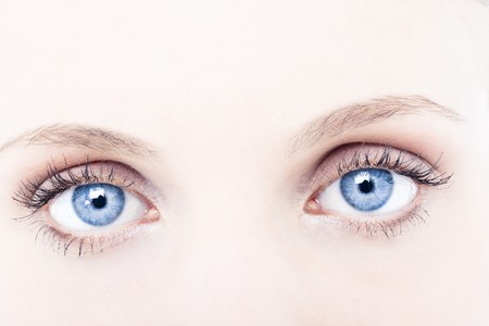 Young woman blue eyes, close-up Stock Photo - 7368816
