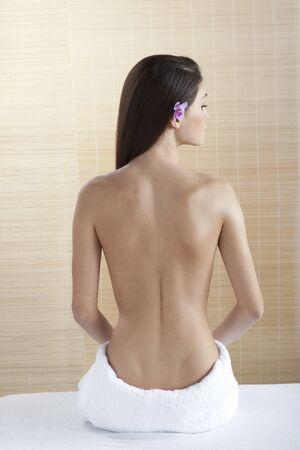 Rear view of a beautiful woman at spa photo