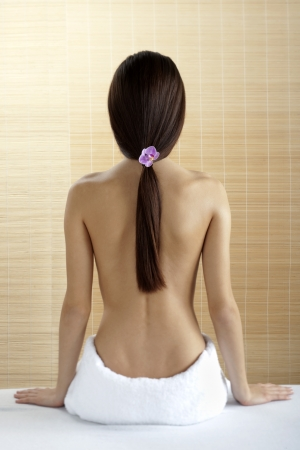 woman in towel: Rear view of a beautiful woman at spa Stock Photo