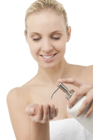 Beauty in towel with liquid soap dispenser photo
