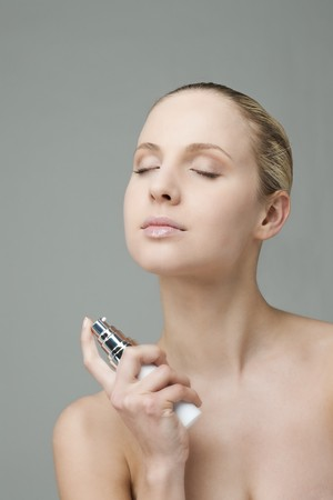 Beauty applying perfume