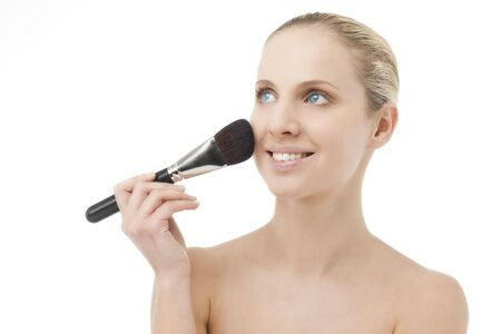 Woman applying powder with a brush Stock Photo - 7368873