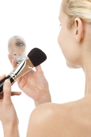 Woman with powder brush and mirror Stock Photo - 7368866