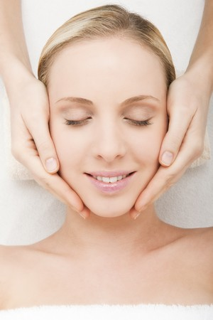 beauty therapist: Close-up of a young woman getting spa treatment.