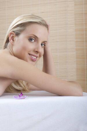 Close-up of a young beautiful woman at spa photo