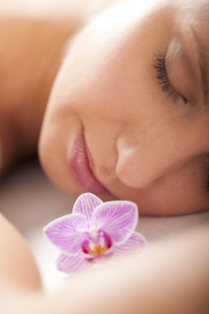 Close-up of a relaxed woman receiving spa treatment, selective focus photo