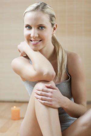 Beautiful woman in underwear, sitting on the floor Stock Photo - 7368955