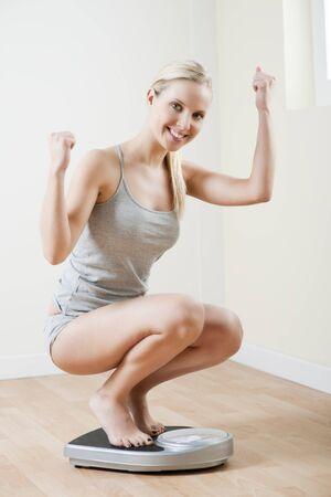 squatting: Dieta exitosa  Foto de archivo