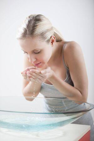 washing face: Beautiful woman washing face Stock Photo
