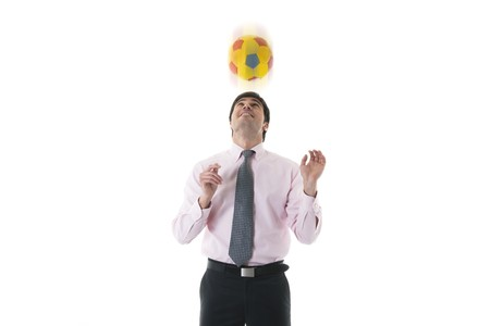 Businessman palying soccerfootball, isolated on white photo