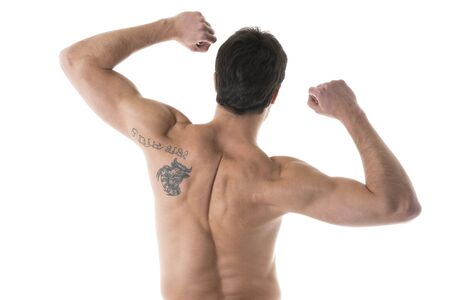 Rear view of a muscular male posing photo