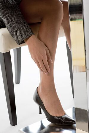 Close-up of businesswoman legs photo