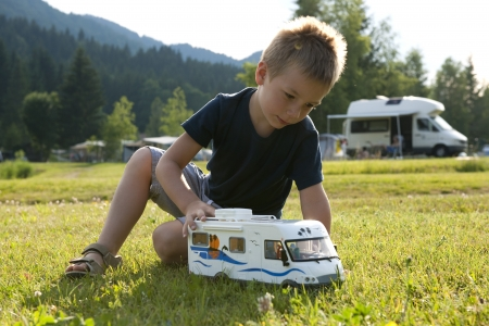 Little boy playing at camping site Stock Photo