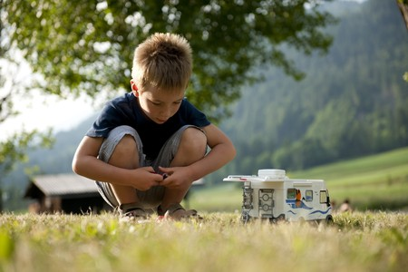 Little boy playing at camping site Stock Photo - 7388303