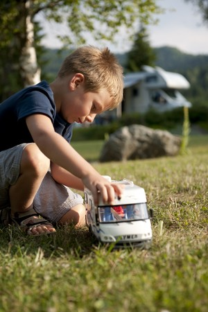 recreational pursuit: Little boy playing at camping site Stock Photo