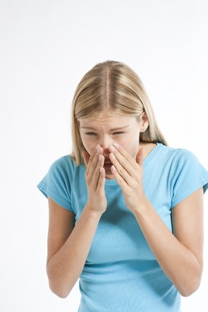 Young woman coughing or sneezing, with both hands over nose Stock Photo - 7388353