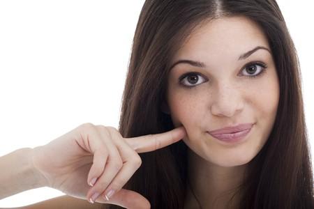 Beautiful young woman touching her cheek, saying I like it! photo