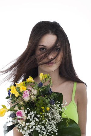 Beauty with a bunch of flowers, hair blowing in her face Stock Photo - 7417509