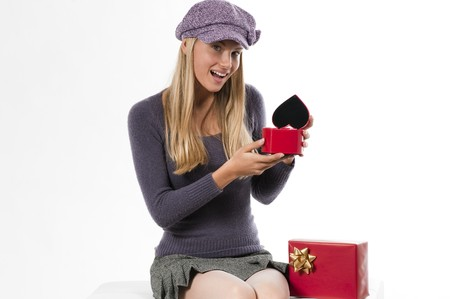 Beautiful young woman receiving a heart shaped box for Valentines Day or Wedding Anniversary photo