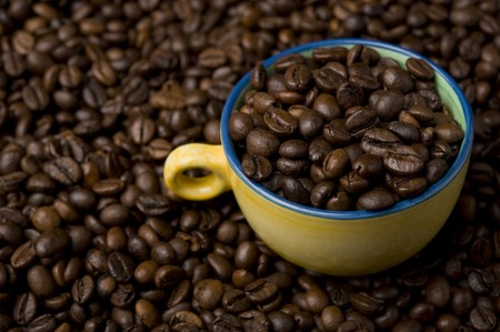 Topview of a glass coffee cup filled with coffee beans photo