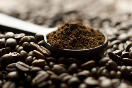 Coffee beans and ground with spoon Stock Photo