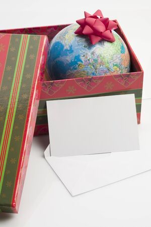 Earth as a present, greeting card for your own text Stock Photo - 7417836