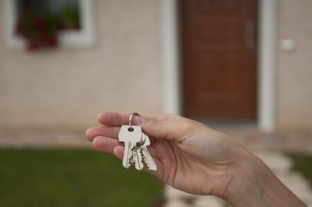 open  women: Woman holding the key of her new house Stock Photo