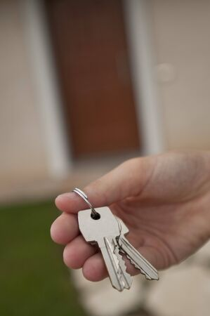 Woman holding the key of her new house photo