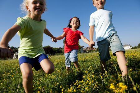 three children: Three children running holding hands