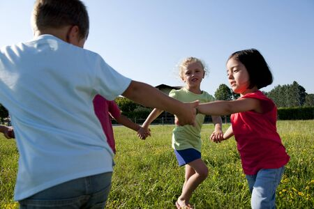 Small group of children playing ring-around-the-rosy photo