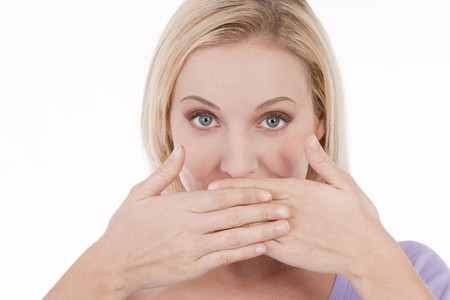 Young woman covering her mouth with hands photo