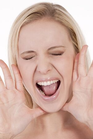Young woman screaming photo
