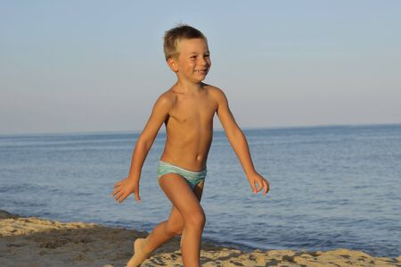 Little boy having fun on the beach photo