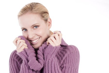 Beautiful young woman in soft sweater, isolated on white photo