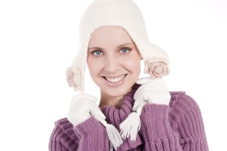 Beautiful young woman in soft sweater, cap and mittens, isolated on white photo