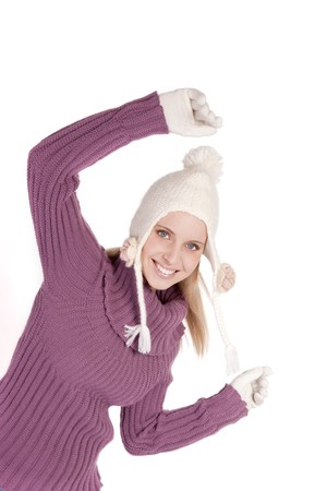 Beautiful young woman in soft sweater, cap and mittens, isolated on white Stock Photo - 7452837