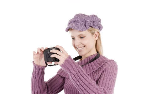 Beautiful young woman with camera, isolated on white photo