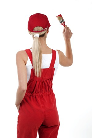 Rear view of a young woman painting; copy space for your own red painting photo
