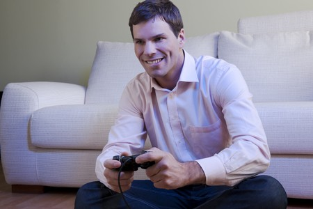 playstation: Young man playing video games