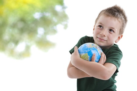 Little boy embracing the globe to protect it photo