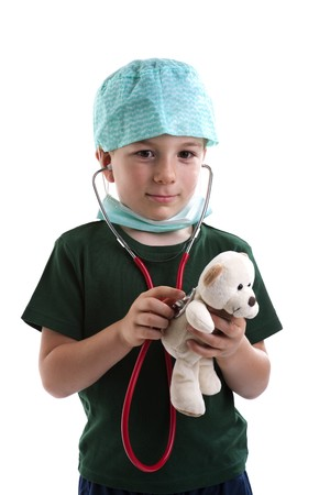 doctor mask: Little boy dressed as surgeon listening to his teddys health