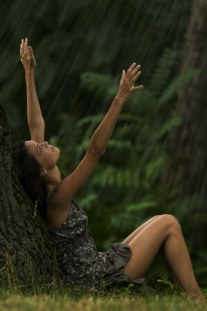 Beautiful woman enjoying rain. Concept: contact with nature. Stock Photo - 7471509