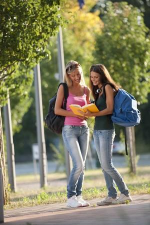 Beautiful female students outdoors Stock Photo - 7511587