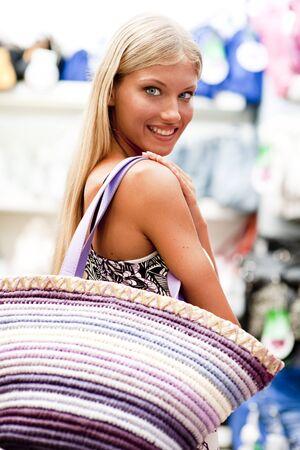 Beautiful young woman doing shopping photo