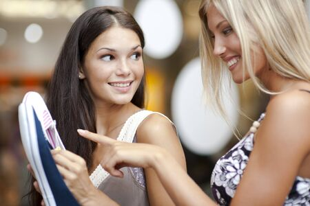 only teenage girls: Young women choosing shoes Stock Photo