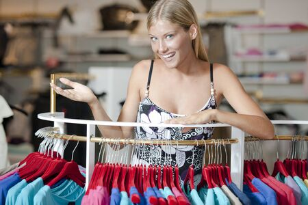 choosing clothes: Young woman choosing clothes