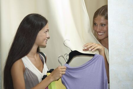Young women trying dress on Stock Photo - 7662897